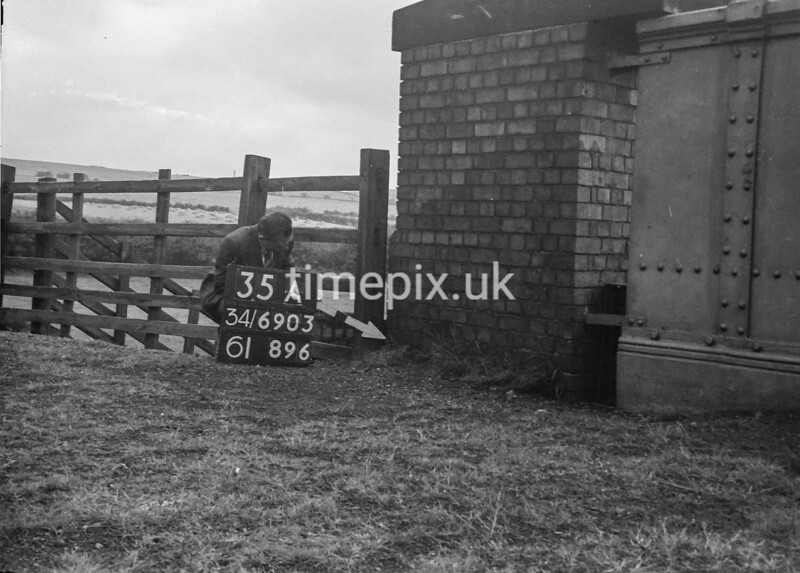 SD690335A, Man marking Ordnance Survey minor control revision point with an arrow in 1950s