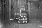 SD690774A, Man marking Ordnance Survey minor control revision point with an arrow in 1950s