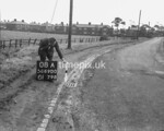 SD690008A, Man marking Ordnance Survey minor control revision point with an arrow in 1950s