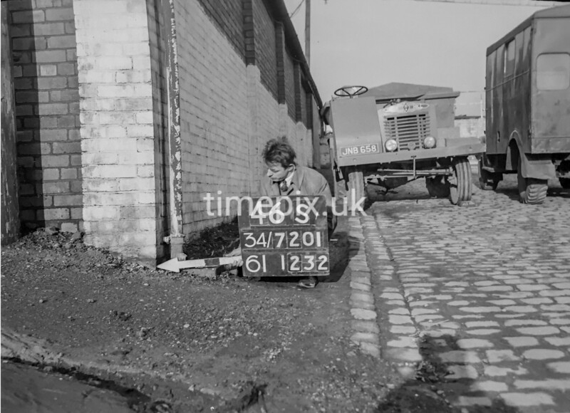 SD720146S, Man marking Ordnance Survey minor control revision point with an arrow in 1950s