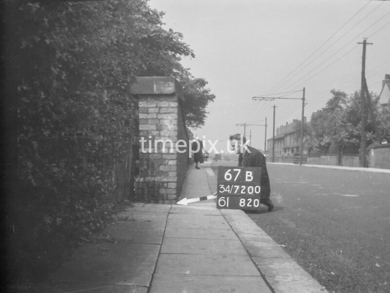 SD720067B, Man marking Ordnance Survey minor control revision point with an arrow in 1950s