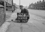 SD690707B, Man marking Ordnance Survey minor control revision point with an arrow in 1950s
