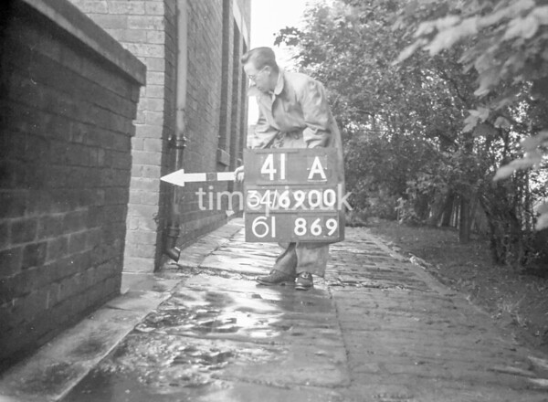 SD690041A, Man marking Ordnance Survey minor control revision point with an arrow in 1950s