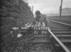 SD690876B, Man marking Ordnance Survey minor control revision point with an arrow in 1950s