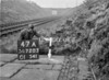SD720347A, Man marking Ordnance Survey minor control revision point with an arrow in 1950s