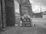 SD690781A, Man marking Ordnance Survey minor control revision point with an arrow in 1950s