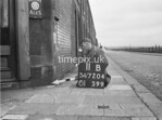 SD720411B, Man marking Ordnance Survey minor control revision point with an arrow in 1950s