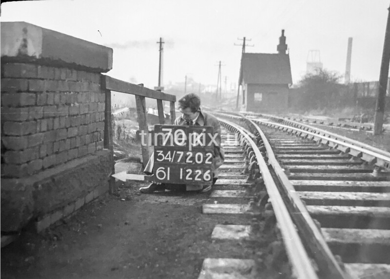 SD720270K, Man marking Ordnance Survey minor control revision point with an arrow in 1950s