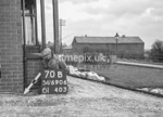 SD690670B, Man marking Ordnance Survey minor control revision point with an arrow in 1950s