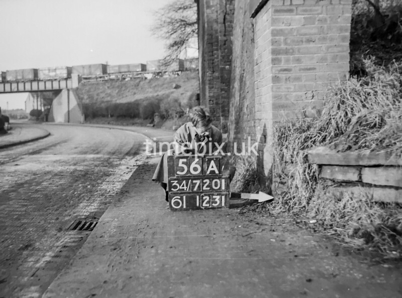 SD720156A, Man marking Ordnance Survey minor control revision point with an arrow in 1950s