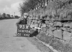 SD690693A, Man marking Ordnance Survey minor control revision point with an arrow in 1950s
