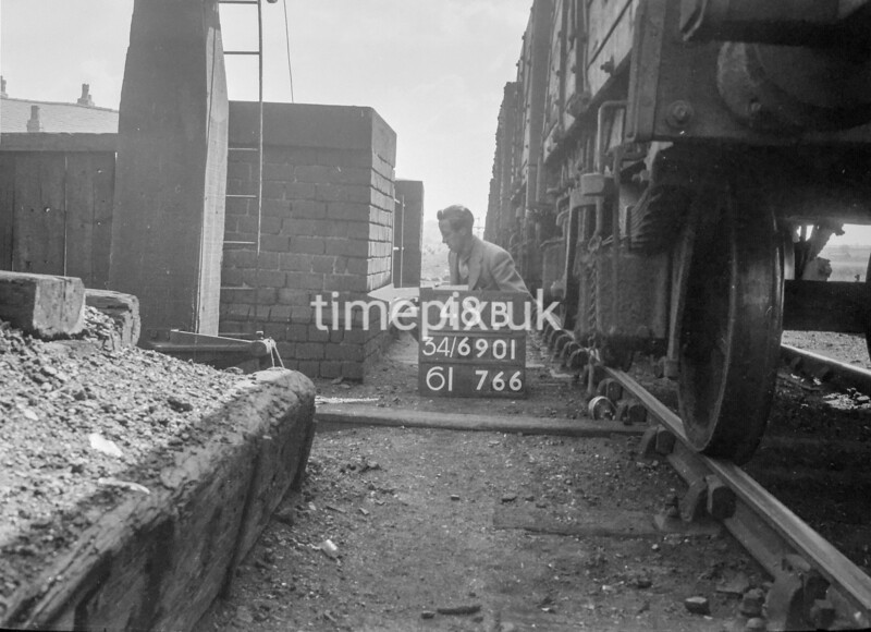 SD690148B, Man marking Ordnance Survey minor control revision point with an arrow in 1950s