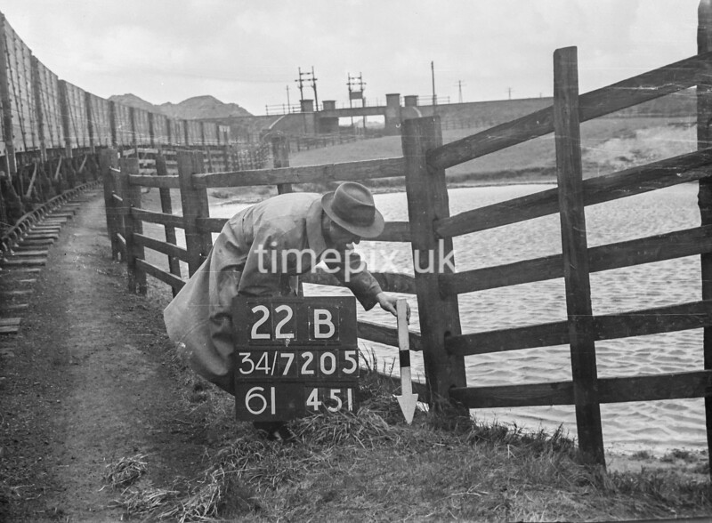 SD720522B, Man marking Ordnance Survey minor control revision point with an arrow in 1950s