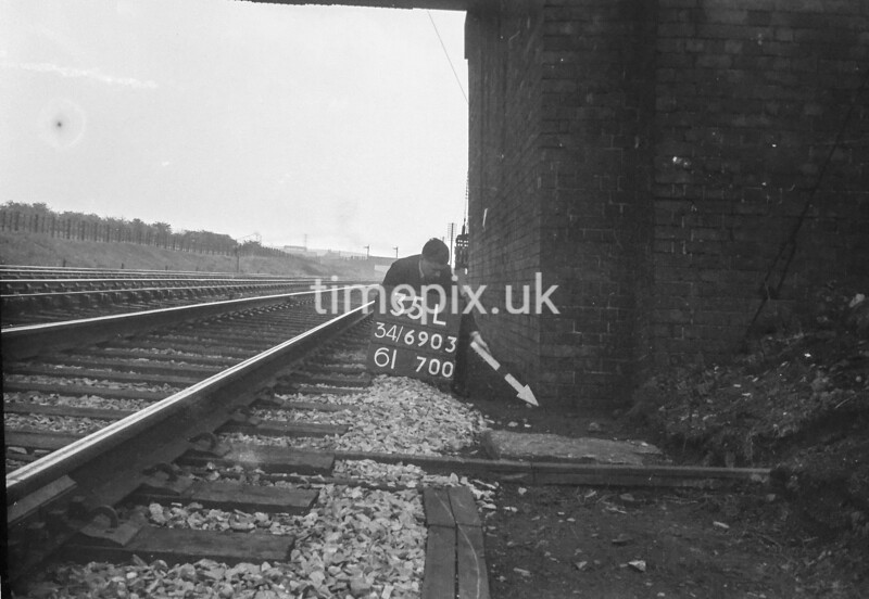 SD690335L, Man marking Ordnance Survey minor control revision point with an arrow in 1950s