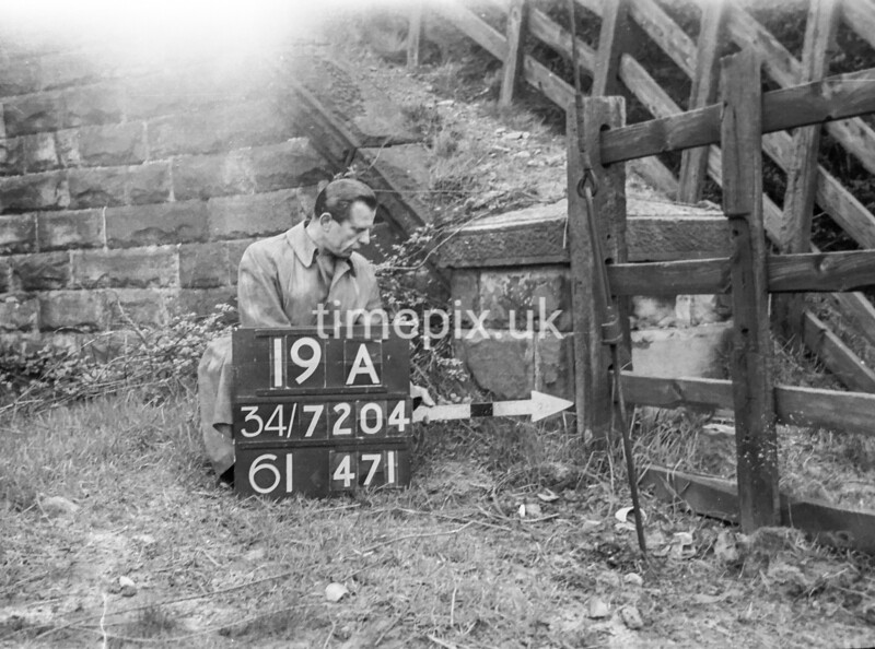 SD720419A, Man marking Ordnance Survey minor control revision point with an arrow in 1950s