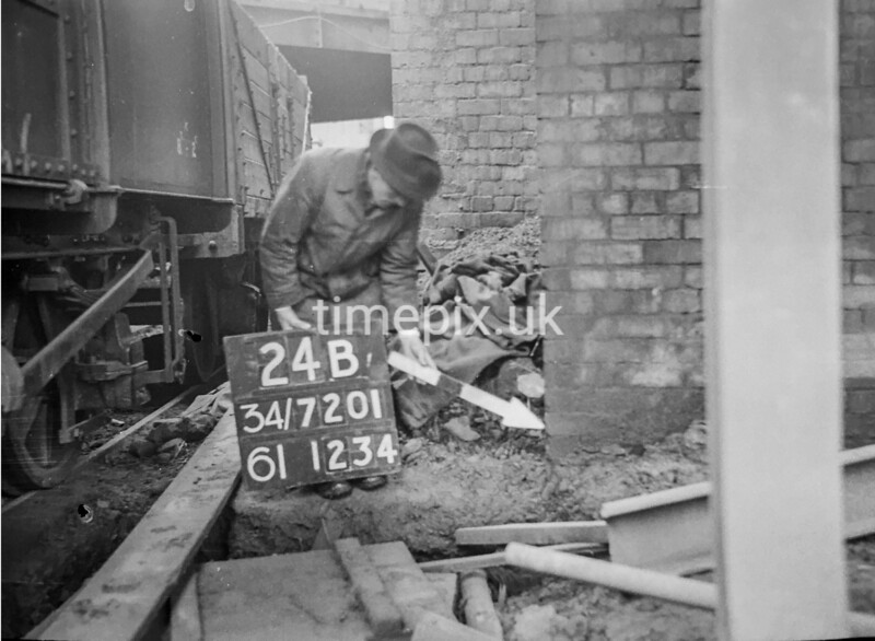 SD720124B, Man marking Ordnance Survey minor control revision point with an arrow in 1950s