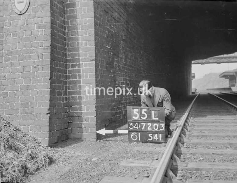 SD720355L, Man marking Ordnance Survey minor control revision point with an arrow in 1950s