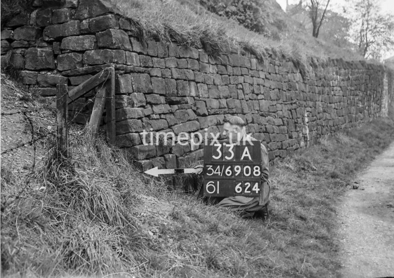 SD690833A, Man marking Ordnance Survey minor control revision point with an arrow in 1950s