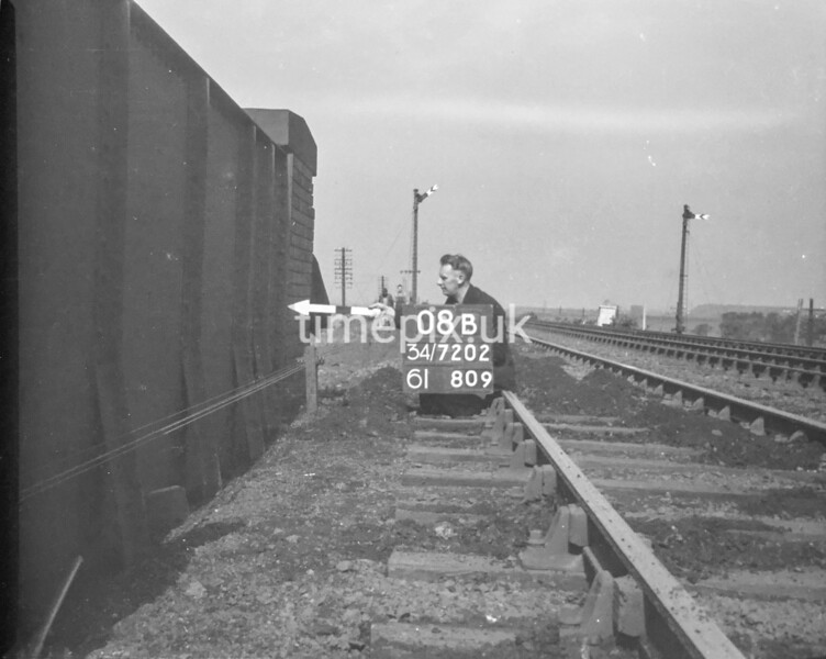 SD720208B, Man marking Ordnance Survey minor control revision point with an arrow in 1950s