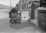 SD690707A, Man marking Ordnance Survey minor control revision point with an arrow in 1950s