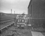 SD690827B, Man marking Ordnance Survey minor control revision point with an arrow in 1950s