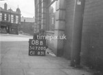 SD720008B, Man marking Ordnance Survey minor control revision point with an arrow in 1950s