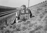 SD690712B, Man marking Ordnance Survey minor control revision point with an arrow in 1950s