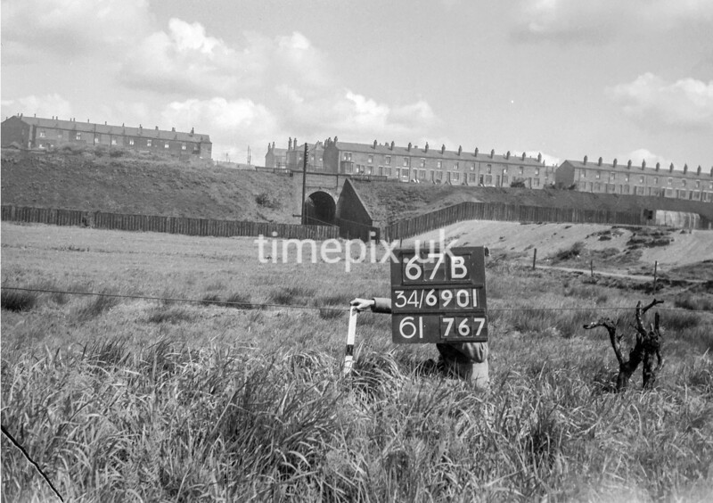 SD690167B, Man marking Ordnance Survey minor control revision point with an arrow in 1950s