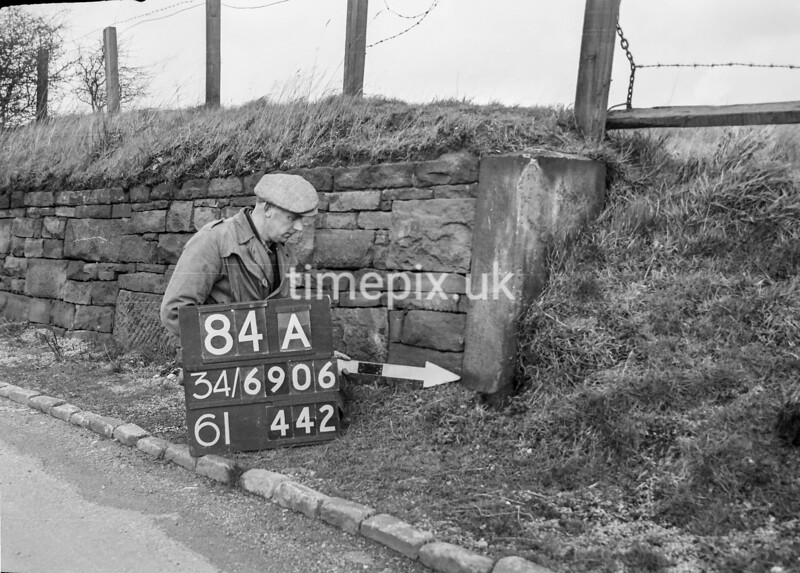 SD690684A, Man marking Ordnance Survey minor control revision point with an arrow in 1950s