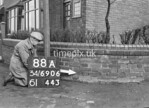 SD690688A1, Man marking Ordnance Survey minor control revision point with an arrow in 1950s