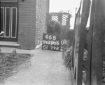 SD690046B, Man marking Ordnance Survey minor control revision point with an arrow in 1950s