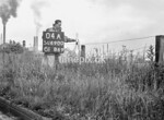 SD690004A, Man marking Ordnance Survey minor control revision point with an arrow in 1950s