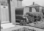 SD720319B, Man marking Ordnance Survey minor control revision point with an arrow in 1950s
