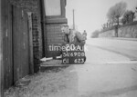 SD690820A, Man marking Ordnance Survey minor control revision point with an arrow in 1950s
