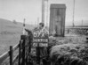 SD690807A, Man marking Ordnance Survey minor control revision point with an arrow in 1950s