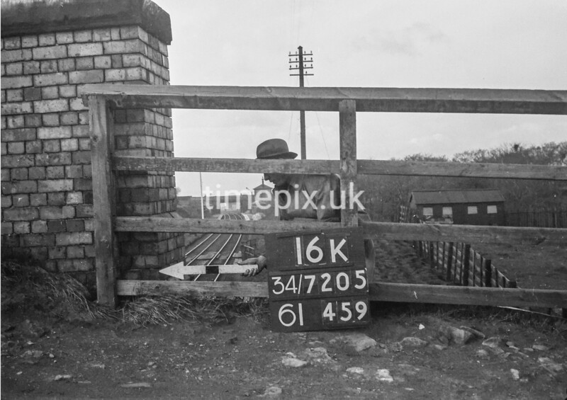 SD720516K, Man marking Ordnance Survey minor control revision point with an arrow in 1950s