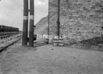 SD690292A, Man marking Ordnance Survey minor control revision point with an arrow in 1950s