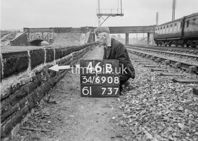 SD690846B, Man marking Ordnance Survey minor control revision point with an arrow in 1950s