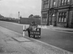 SD720114A, Man marking Ordnance Survey minor control revision point with an arrow in 1950s