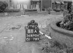 SD690688A2, Man marking Ordnance Survey minor control revision point with an arrow in 1950s
