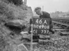 SD690846A, Man marking Ordnance Survey minor control revision point with an arrow in 1950s