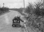 SD690692A, Man marking Ordnance Survey minor control revision point with an arrow in 1950s