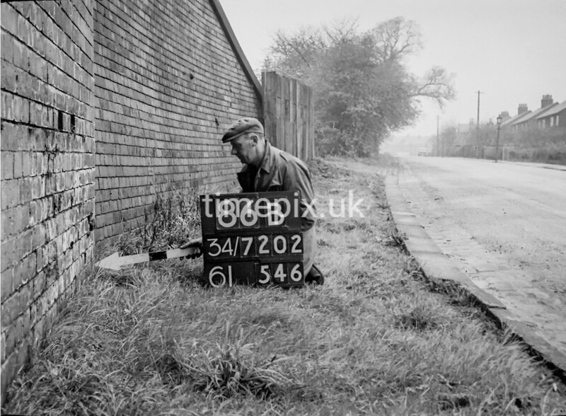 SD720286B, Man marking Ordnance Survey minor control revision point with an arrow in 1950s
