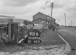 SD690690B, Man marking Ordnance Survey minor control revision point with an arrow in 1950s