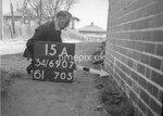 SD690715A, Man marking Ordnance Survey minor control revision point with an arrow in 1950s