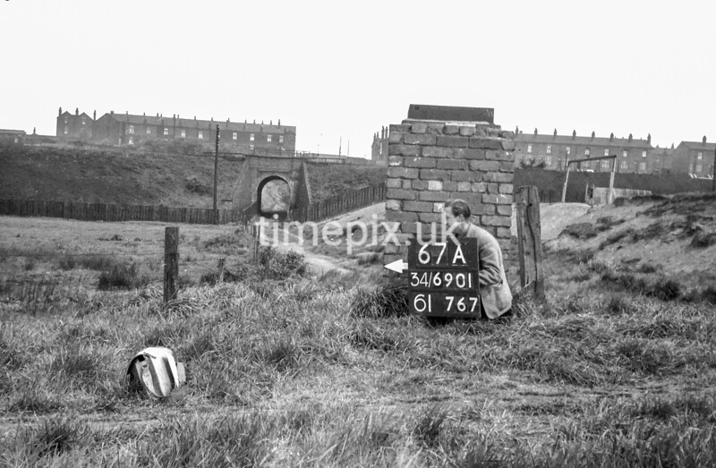 SD690167A, Man marking Ordnance Survey minor control revision point with an arrow in 1950s