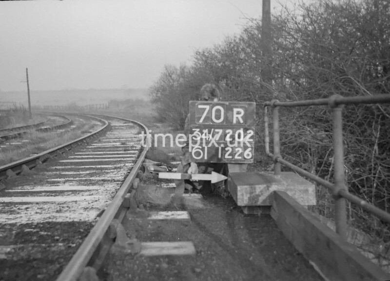 SD720270R, Man marking Ordnance Survey minor control revision point with an arrow in 1950s