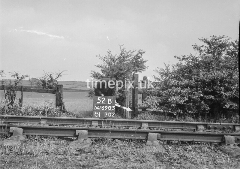 SD690352B, Man marking Ordnance Survey minor control revision point with an arrow in 1950s