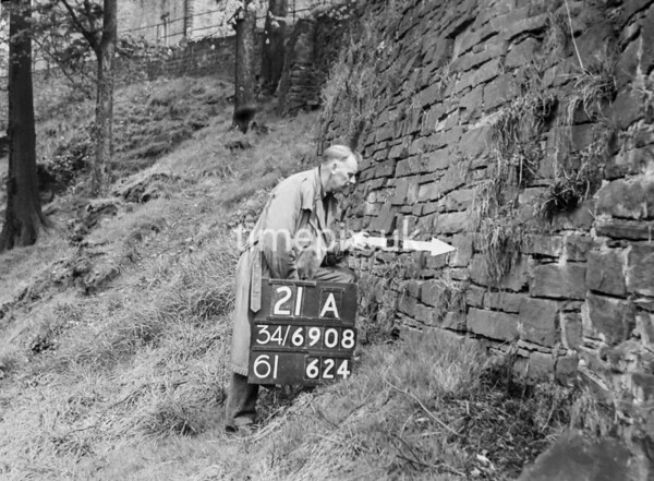 SD690821A, Man marking Ordnance Survey minor control revision point with an arrow in 1950s
