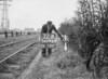 SD690372B, Man marking Ordnance Survey minor control revision point with an arrow in 1950s